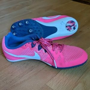 Girl's Nike Rival M cleats, pink sneakers